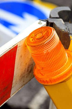 warning lights: Flashing warning orange beacon at construction site