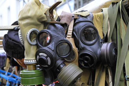 Old military biohazard protection gas masks equipment Stock Photo - 16127039
