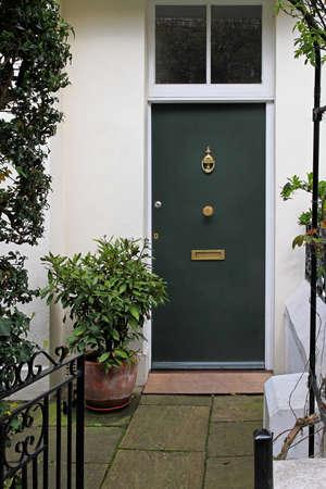 green door: Residential house doorway with green door and patio Stock Photo