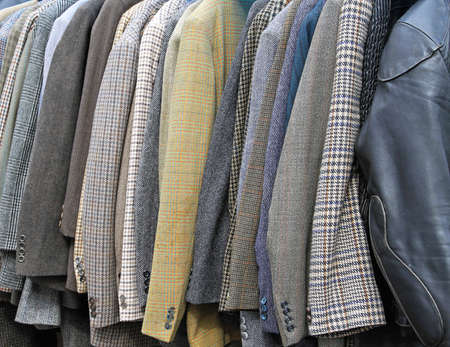 Old retro style suits and coats at rail Stock Photo - 16127075
