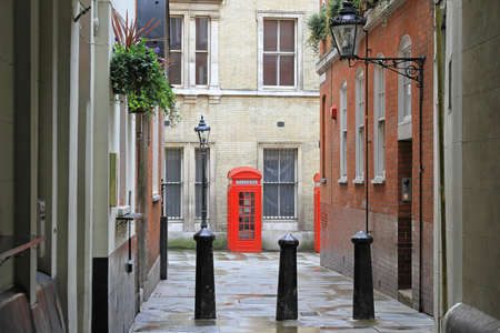 Traditional British red telephone boot at small street Stock Photo - 16127048