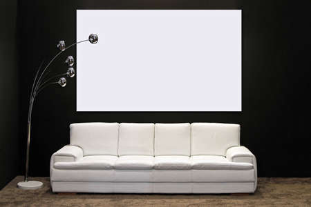 seater: White leather four seater sofa in modern living room