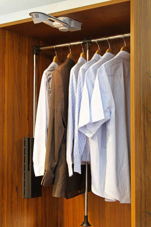 Modern wardrobe closet with shirts and suit Stock Photo - 16246924