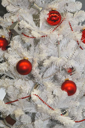 Artificial white Christmas tree with red pendants Stock Photo - 16246937