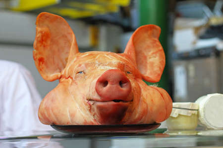 Decapitated pig head with big ears in butcher shop Stock Photo - 16246982