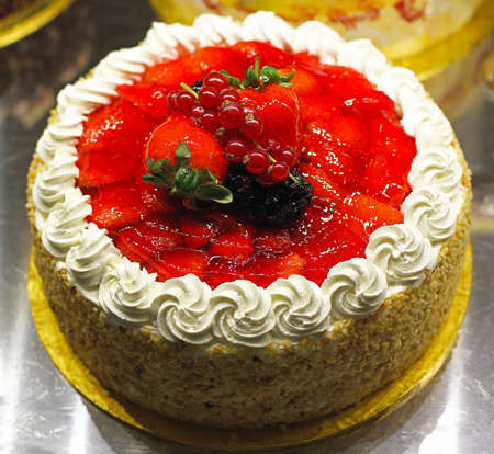 Fancy cake with strawberries and red currants Stock Photo - 16246984