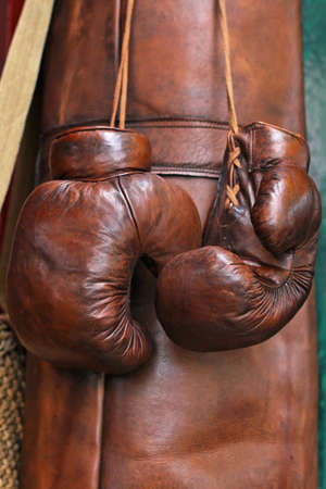Vintage sport boxer gloves and leather sack Stock Photo - 16325570