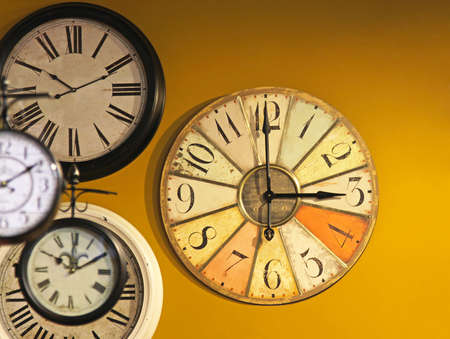 Vintage and grunge clocks at yellow wall Stock Photo - 16325484