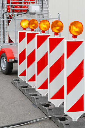 Road barrier with amber beacon flashing lights Stock Photo - 16494554