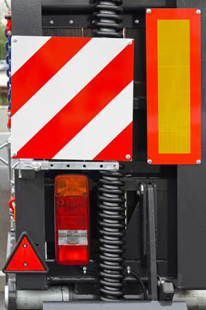 Trailer lights and retroreflective warning traffic signs photo