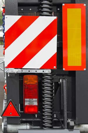 warning lights: Trailer lights and retroreflective warning traffic signs Stock Photo