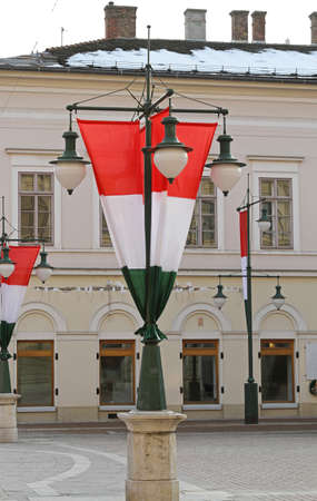 lampost: Hungary flag at chandelier lamp pols in Szeged