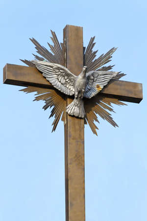 silver cross: Silver dove with open wings at cross peace symbol