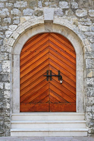 Wooden arch doors at medieval castle in Budva photo