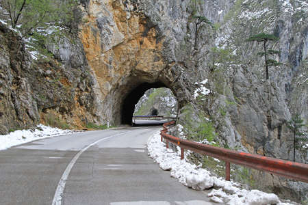 Mountain road with many tunnels in Montenegro photo