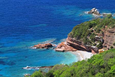 montenegro: Hidden beach in rocky shore at Adriatic sea Stock Photo
