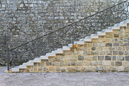 Medieval stone stairway with iron work fence Stock Photo - 16549958
