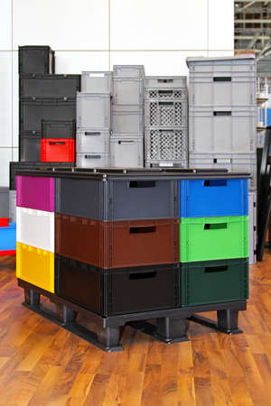 Colour plastic crates and boxes at transportation pallet Stock Photo - 16574469