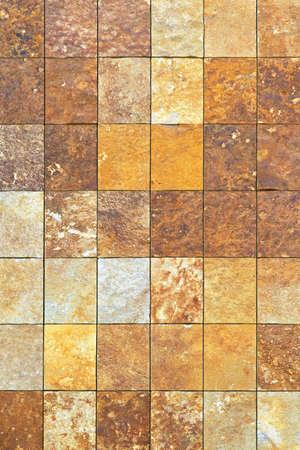 Rough brown marble tiles at building facade Stock Photo - 16574477