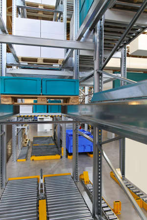 Pallet transport system integrated in racks and shelves Stock Photo - 16574476