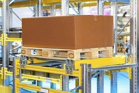 Pallet with cardboard box at shelf in storehouse Stock Photo - 16574465