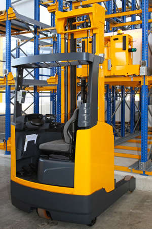 Reach forklift truck in modern distribution warehouse photo