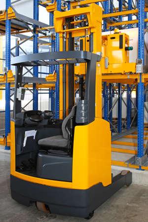 reach truck: Reach forklift truck in modern distribution warehouse