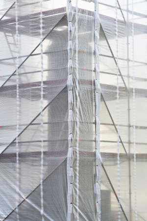 restauration: Monument restauration and construction scaffolding fence Stock Photo