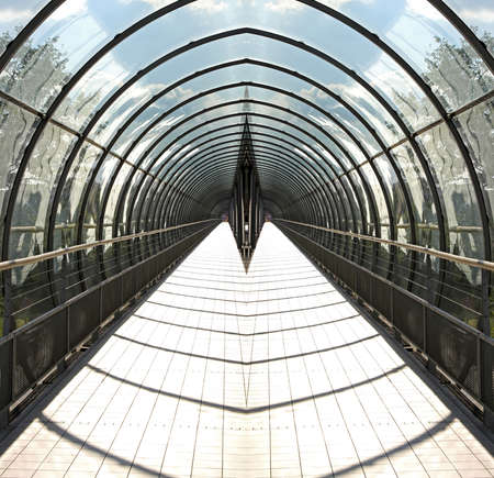 vanishing: Glass tunnel for pedestrian with vanishing perspective Stock Photo