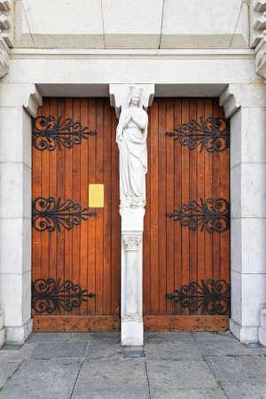Double doors at Basilica of Notre Dame de Nice Stock Photo - 16617409