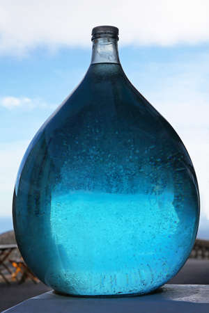 Blue aqua liquid in big glass bottle Stock Photo - 16617389
