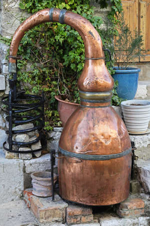 whisky: Medieval distiller made from copper for brandy