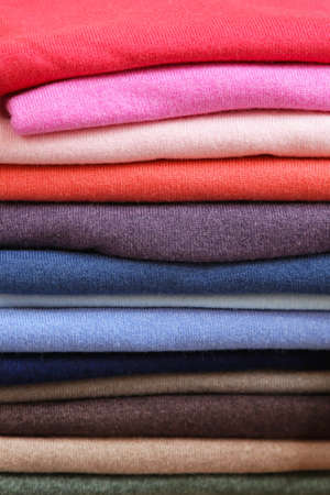 Big pile of vivid color sweaters and jumpers Stock Photo - 16617391