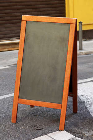 Empty black chalk board at pavement sidewalk Stock Photo - 16648979