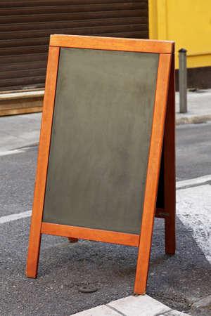 Empty black chalk board at pavement sidewalk Stock Photo - 16648979