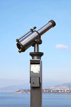 operated: Coin operated monocular telescope at French Riviera Stock Photo