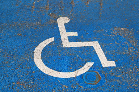 Handicapped sign at asphalt for disabled parking photo