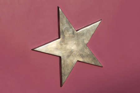 shinny: Goden 3d pentagram star at purple background Stock Photo