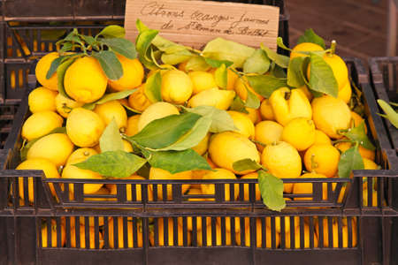 Lemons with leaves in the crate at market Stock Photo - 16686541