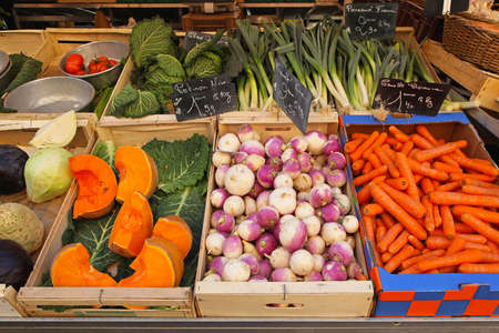 Variety of vegetable groceries in crates at market Stock Photo - 16686660