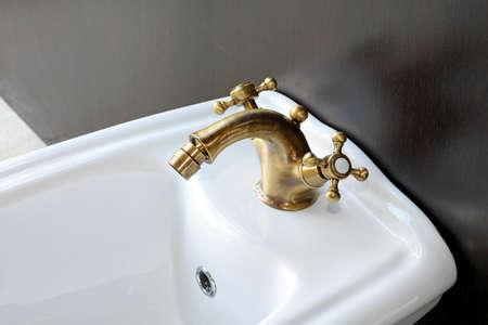 bidet: Retro style bidet with manual brass faucet Stock Photo