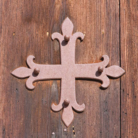 Iron cross at old church wooden door Stock Photo - 16723792