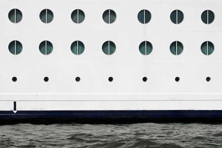 Round windows at white cruise ship side Stock Photo - 16723795