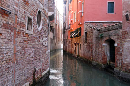 Narrow canal streets in old Venice city Stock Photo - 16723794