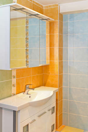 Cabinets and sink in colorful orange bathroom Stock Photo - 16732515