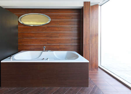 Big hydro massage bathtub in wooden bathroom Stock Photo - 16732510