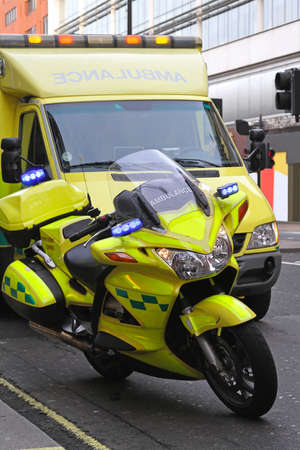 Ambulance motorcycle and van at London streets photo