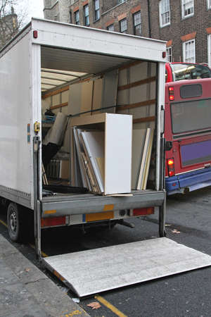 Moving truck rental parket at busy street photo