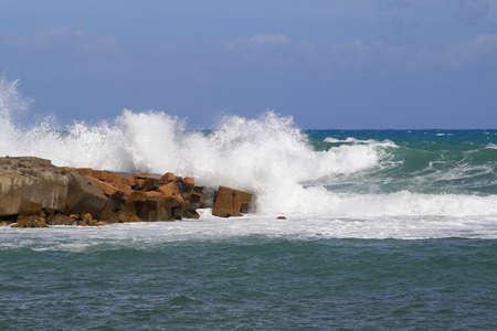 alexandria egypt: Big waves hitting concrete breakwall at Mediterranean sea Stock Photo