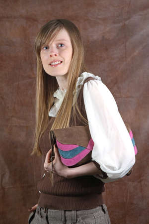 Young blonde woman with modern letter purse photo